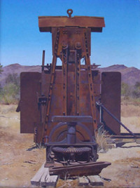 A rusted old machine in the desert.