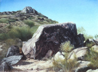 Landscape featuring a rock with petroglyphs in Arizona.